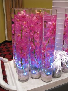 Submerged centerpieces - sand at the bottom is pretty too! either glass rocks, or sand at the bottom...with the glow stick! And a floating candle on top...LED if i can find