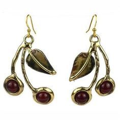 Carnelian Cherry Brass Earrings Handmade and Fair Trade. Handcrafted by South African artisans, these ornate cherry design brass earrings are accented with a carnelian stone. The earrings are 2 inches in length and hang from brass hooks.