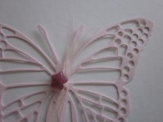 3D paper butterfly wall art in 2 shades of pink with 3 glass stars  --- Perfect to make a sunburst or let them fly around on your wall. €22,50, via Etsy.
