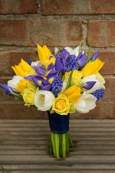 {Bride's Bouquet: White Tulips, Yellow Tulips, Yellow Roses, Purple/Yellow Iris, Blue Muscari Hyacinth, & Green Foliage·················································}