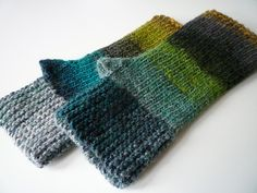 These fingerless mitts are worked in two directions. The hand portion is worked flat in garter stitch. Stitches are picked up and worked in rounds for the thumb and wrist portion.