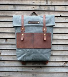 Waxed canvas backpack / rucksack with folded top and waxed leather shoulderstrap. $209.00, via Etsy.