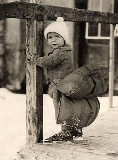 Dutch boy with a pillow strapped on his backside in order to soften the fall while skating. The Netherlands, 1933.