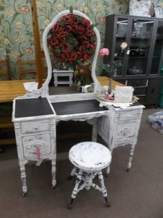 SOLD - Antique vanity with four drawers, mirror and adjustable ball and claw stool - painted creamy white with black surface areas & distressed. ***** In Booth H12 at Main Street Antique Mall 7260 E Main St (east of Power RD on MAIN STREET) Mesa Az 85207 **** Open 7 days a week 10:00AM-5:30PM **** Call for more information 480 924 1122 **** We Accept cash, debit, VISA,