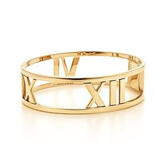 Tiffany & Co. | Item | Atlas® hinged bangle in 18k gold, medium. | United States
