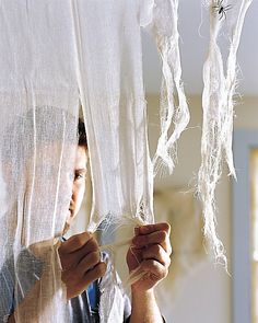 Great tips on Hanging and tearing cheesecloth for Halloween decorating. I love Martha Stewart's Halloween ideas! Halloween Prop, Deco Haloween, Soirée Halloween, Halloween Office, Adornos Halloween, Halloween Birthday, Holidays Halloween, Pirate Halloween Decorations, Halloween Wall Decor