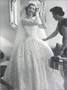 1950.  Absolutely, stunningly beautiful.  Not  just because of the dress, but because of the joy that is radiating off her face.