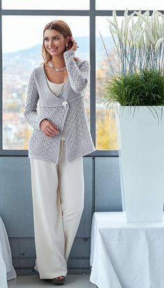A beautiful lace pattern adorns the lower part of this jacketwith overlapping fronts, while garter stitch rules on the toppart. The stitch patterns are divided by a tuck and the jackethas identical hems. A deep elegant v-neck allows it to beworn loose creating waterfall fronts. Or you can close it withjewelry or a shawl pin for a more tailored look. The jacketis named Sarya; the night traveler hence knitted in thestunning Jagger Spun, Zephyr Lace, held double, because ofits luster…