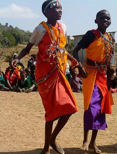 Two children dancing in the Maasai Mara in Kenya. Photo credit: Rachel Cairns, ONE member.