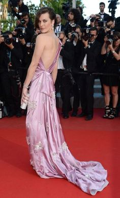 Milla Jovovich donned an embellished asymmetric lilac silk dress, complete with sweeping train, by Prada.