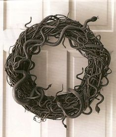 Dollar store snakes and spray paint = one slithery Halloween wreath.