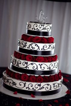Love the roses, design is a bit simple. Colors are WONDERFUL! (Yes, I want a goth wedding...)