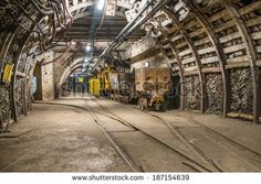 https://thumb7.shutterstock.com/display_pic_with_logo/670744/187154639/stock-photo-train-and-carts-in-coal-mine-187154639.jpg