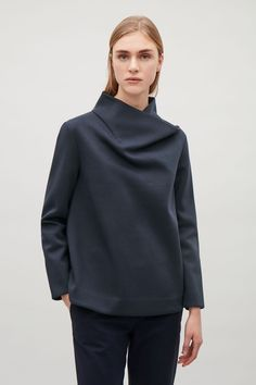 Designed with a draped, standing neckline, this long-sleeve top is made from a smooth bonded jersey. A slight A-line fit, it has a straight hemline and neat finishes.