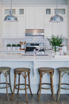 white kitchen with Thonet bentwood stools via lovelucygirl.com