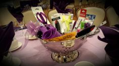 Need a good centerpiece idea? Kitchen Colander filled with kitchen utensils for guests to take home!