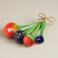 One of my favorite discoveries at WorldMarket.com: Berry Measuring Spoons @aimee nicole I thought you would like these.