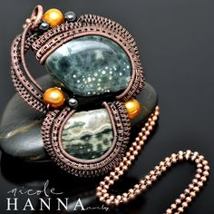 Gorgeous green ocean jasper, with small yellow and white inclusions, is the focal of this wire wrapped copper pendant. This handmade pendant is one of a kind, and features many yards of hand-coiled, wrapped and woven copper wire, capturing stones and gold freshwater pearls. Small hematite also ac...