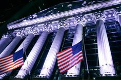 American flags fly in front of the New York Stock Exchange as Wall Street winds down the year in this holiday-shortened week.