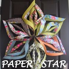 Paper star tutorial - They become giant snowflakes hung in front of windows. Add in glitter and stickers for more fun! Or even glitter paper!