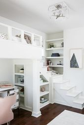 Shared girls' bedroom features a blush pink velvet chair placed at a white desk accented with a chrome trim and placed beside a styled built-in bookshelf and beneath a white loft bed lit by a square lucite light pendant . Girls Bedroom With Loft Bed, Bedroom Desk, Small Room Bedroom, Bedroom Loft, Trendy Bedroom, Dream Bedroom, Girl Bedrooms, Unique Teen Bedrooms, Bookshelves Built In