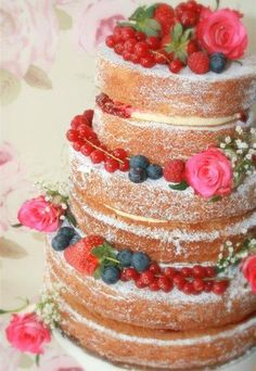 Wedding-cake with berries and flowers.