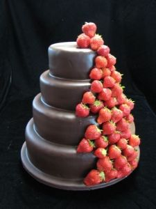 "Cascading Strawberries Wedding Cake --- Looks like the whole cake is encased in a hard chocolate dip shell, with ""naked""strawberries cascading down."