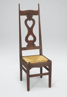 Chair, c.1898 Oak and rush This chair is one of a pair from a set of six designed by C.F.A. Voysey for W. Ward-Higgs Esq. (1866–1936) at 23 Queensborough Terrace, London.