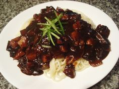 jjajangmyun...need i say more for the kids who grew up on this...korean comfort food. noodles with blackbean sauce. don't be scared because it's black...it's sooooo good.