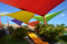 Bright coloured shade sails at early learning centre. shade cloth from Rainbow Shade used. Pergola Swing, Pergola With Roof, Backyard Pergola, Pergola Kits, Pergola Ideas, Patio Shade, Pergola Shade, Roof Design, Patio Design