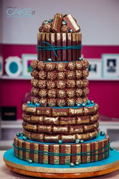 Tim Tams, Butterfingers, Ferrero Rochers and Kit Kats - oh my! This cake is the TRUE chocolate-lover's dream come true!! Click to watch me make this for a SPECIAL client this Valentine's Day!