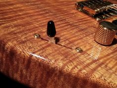 Bruno Traverso Guitars - detail of the 5A curly flame KOA body, switch. Consider the amzing craftmanship and immense attention to detail. The Koa body with glossy finish it's an istant heartbreaker.