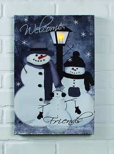 "Dimensions: 12""W x 18""L Stretched canvas Flickering Lights AA Batteries On / Off switch .A family of snowmen offers you a winter greeting in the LIGHTED SNOW WE"