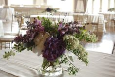 Arrangement including dark purple lilacs.