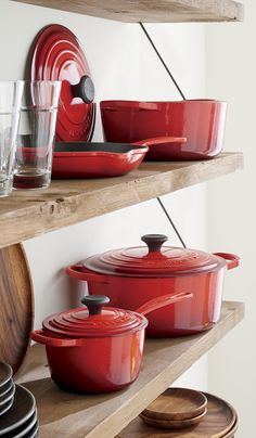 "evered by both professional chefs and home cooks since its 1925 debut, Le Creuset's classic French cookware is prized for its utilitarian good looks, unsurpassed heat retention, and lids that create an even ""blanket"" of heat. Cast iron is clad in smooth, Kitchen Buffet, Kitchen Shelves, Kitchen Utensils, Kitchen Gadgets, Kitchen Decor, Red Kitchen Appliances, Gold Kitchen, Kitchen Rustic, Open Shelves"