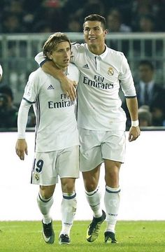 Real Madrid's Cristiano Ronaldo celebrates scoring their fourth goal with Luka Modric