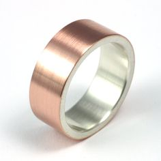 Steampunk Wedding Band - Rose Gold and Silver. $350.00, via Etsy.