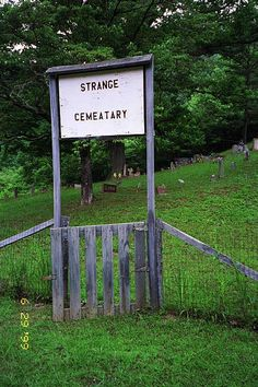 "The Strange Cemetery is located in Kite, Knott County, Kentucky. The cemetery is easy to miss, there is a dirt driveway up the side of Route 7, one mile south of the junction of 582 and Route 7. The driveway goes up a hill, over rail road tracks. In some places, the cemetery is listed as the King Cemetery, in others it is listed as the Strange Cemetery. The sign on the gate clearly shows Strange, while the sign is misspelled ""Cemeatery"" -- or maybe that is the way they meant it!"