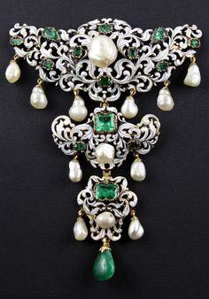 An antique gold, enamel, emerald and pearl devant de corsage, 19th century. #antique #DevantDeCorsage