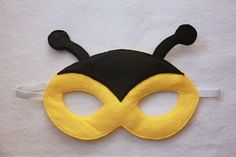 Simple Bee Mask idea (maybe add stripes & flower rosette for the girls). Also make lady bug, frog, etc. ones (instead of woodland animals like last year): Backyard Campout Twin Costumes, Diy Masque, Felt Mask, Bee Party, Felt Patterns, Mask Making, Mask For Kids, Felt Crafts, Crafts For Kids