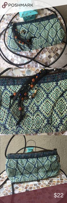 """20%⬇️Perfect festival purse in blue & green print The muted blues and greens in this cross body purse are super cute and sure to match anything! One zipper at top for closure. Fun tassel with wood beads, seed beads and bells! Braided crossbody strap- guessing faux leather - drop is 26"""". NWOT NEVER BEEN USED! ✅I ship same or next day ✅Bundle for discount Limited Edition Bags Crossbody Bags"""