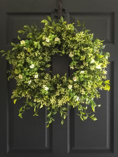 Boxwood Wreath with White Tea Leaf Flowers | Display Wreath Year Round Indoors & Outdoors as Wall Door, as a Door Wreath, or as Office Decor by HomeHearthGarden on Etsy https://www.etsy.com/listing/230702869/boxwood-wreath-with-white-tea-leaf