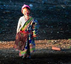 Tibetan girl in traditional Chuba by reurinkjan, via Flickr