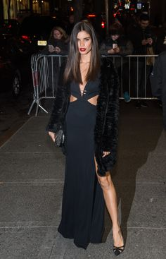 Sara Sampaio wearing a Philipp Plein dress and Salvatore Ferragamo heels.