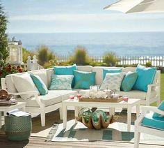 Terraza y jardín en la costa