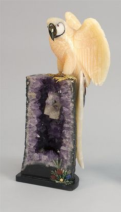 "QUARTZ AND AMETHYST CARVING OF A PARROT 20th Century <br  /> Attributed to Peter Muller. Tiger's-eye beak, gilt claws, and various stone inlays. Height overall 24.5""."