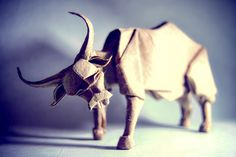 Designed by Gen Hagiwara Madrid-based origami enthusiast Gonzalo García Calvo has a knack for fiddling with paper. He uses a variety of different techniques and papers to fold impressive animals, objects, and sci-fi figures designed by a number of top origami artists. By day Gonzalo works professio