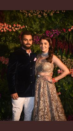 Virat Kohli and Anushka Sharma at their Grand Reception in Mumbai Dec 2017 Anushka's in a Sabyasachi vintage style Lehenga with hand-beaten silver thread textured sequins and organza flowers Virat's in Jodhpuri Suit by Raghavendra Rathore via Reception Suits, Indian Reception, Wedding Reception, Wedding Bride, Anushka Sharma Virat Kohli, Virat And Anushka, Anushka Sharma Images, Lace Dresses, Formal Dresses
