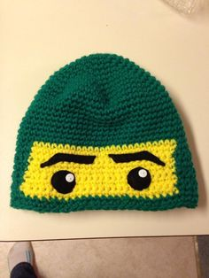 Green Ninjago crochet hat with felt and button detailing