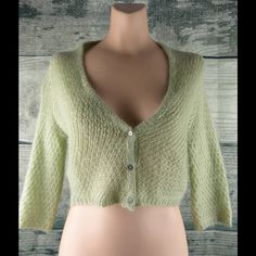 Free People Cardigan.  Size Medium So cute!  As new condition.  45% mohair, 30% nylon and 25% acrylic.  Sage green with silver buttons.  Measures 18 inches from shoulder to hem.  Measures 18 inches side to side at the under arm.  Comes from a non-smoking environment. Free People Sweaters Cardigans